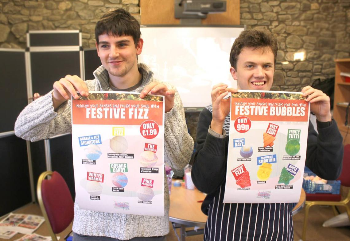 Boys holding Bubble & Fizz posters