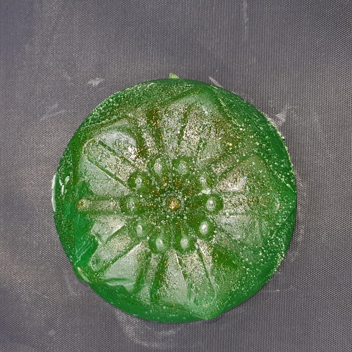 Circle green flower soap with glitter.