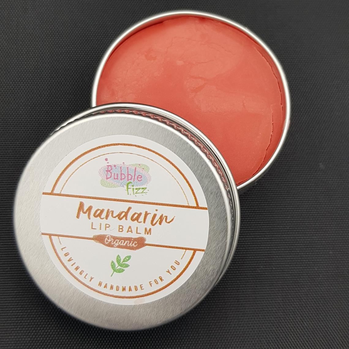 Close up of mandarin lip balm.