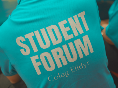 Close up of a Coleg Elidy shirt with Student Forum written on the back